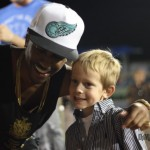Big Sean takes a photo with one of his younger fans.