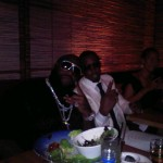 "Rick Ross and Diddy throws up the ""peace sign"" up at dinner."