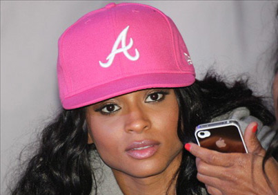 Ciara uses her white iPhone in the club.
