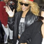 Rihanna Rocks Red Baseball Cap with Wavy Hair
